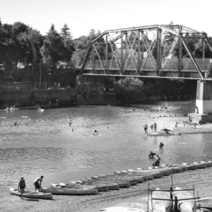 Russian River Canoes, Healdsburg, CA black and white canoes at the bridge
