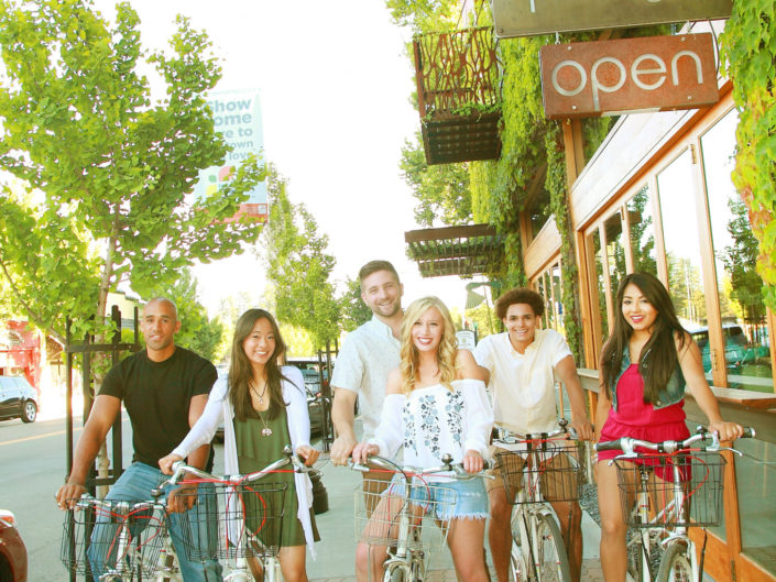 diverse group riding bike