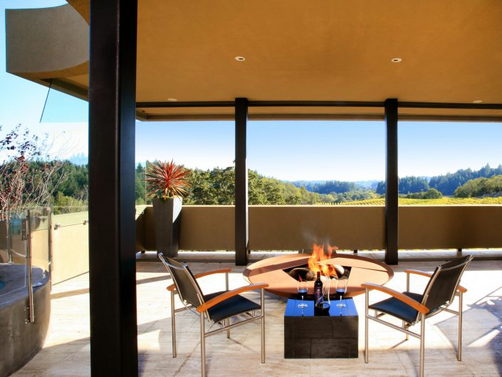Modern firepit overlooking vineyards