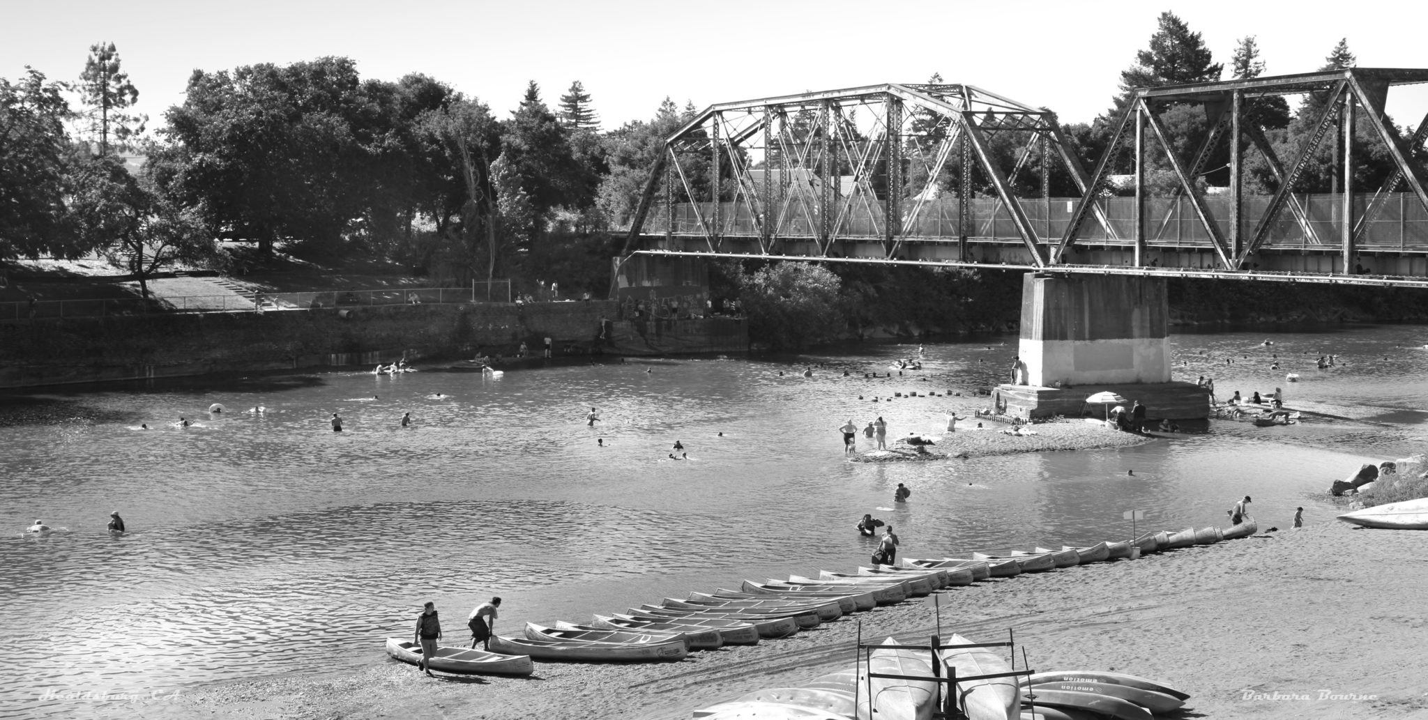 Russian River Canoes, Healdsburg, CA black and white canoes at the bridge