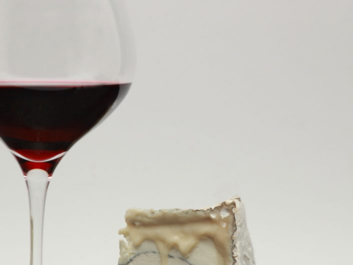 glass of red wine and stilton